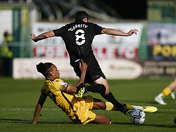 Sutton United's Alistair Smith (left) tackles Port Vale's Ben Garrity during the Sky Bet League Two match at Borough Sports Ground, Sutton. Picture date: Saturday October 9, 2021.