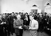 To mark his retirement from the Defence Forces, Irish international rugby legend Ciaran Fitzgerald is presented with a hi-fi system by Brigadier General Vincent Savino on behalf of his friends and colleagues.<br /> 5 September 1986