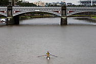 Despite recreational boating being banned under state 4 restrictions, a rower in a single scull is seen on the Yarra River with the Princes Bridge seen in the background during COVID-19 in Melbourne, Australia. Victoria has recorded 14 COVID related deaths including a 20 year old, marking the youngest to die from Coronavirus in Australia, and an additional 372 new cases overnight. (Photo by Dave Hewison/Speed Media)