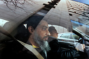 **DON'T USE PHOTO. Photo is reserving this for a future run date ** PORTLAND, OREGON-3/7/13--Reaz Khan, a Portland city employee charged with aiding terrorism, leaves the the U.S Federal Court building (reflected in car window) after being released from custody Thursday pending the a trial. Photo by Randy L. Rasmussen/The Oregonian
