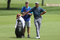 August 9, 2018 - St. Louis, Missouri, United States - Tiger Woods (R) and his caddie Joe LaCava wait on the fairway during the first round of the 100th PGA Championship at Bellerive Country Club. (Credit Image: © Debby Wong via ZUMA Wire)