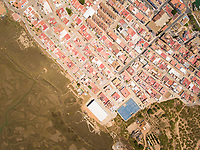 Aerial view of city surrounded by wetland in Andalusia, Spain.
