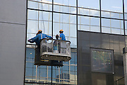 close up of two window washers at work