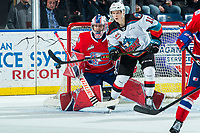 KELOWNA, BC - JANUARY 31: Lukáš Pařík #33 of the Spokane Chiefs defends the net as Pavel Novak #11 of the Kelowna Rockets keeps his eye on the puck during third period at Prospera Place on January 31, 2020 in Kelowna, Canada. Pařík is a 2019 NHL entry draft pick of the Los Angeles Kings. (Photo by Marissa Baecker/Shoot the Breeze)