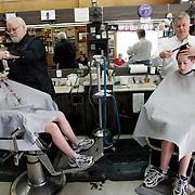 A man reads the newspaper in a local barber shop in Augusta, Georgia.