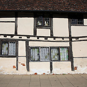 Mason's Court, Stratford-upon-Avon, The medieval building in Rother Street is reputed to have been built around 1450 and to be oldest dwelling-house in the town. Stratford-upon-Avon is a market town and civil parish in south Warwickshire, England. It lies on the River Avon. The town is a popular tourist destination owing to its status as birthplace of the playwright and poet William Shakespeare, receiving about 3 million visitors a year. The Royal Shakespeare Company resides in Stratford's Royal Shakespeare Theatre. Photo Tim Clayton