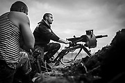 A soldier is shooting a mini-grenade launcher towards the position of four men, caught trying to remove anti-tank mines positioned by the Ukrainian military to protect the frontline of Hranitne, near Mariupol, eastern Ukraine.