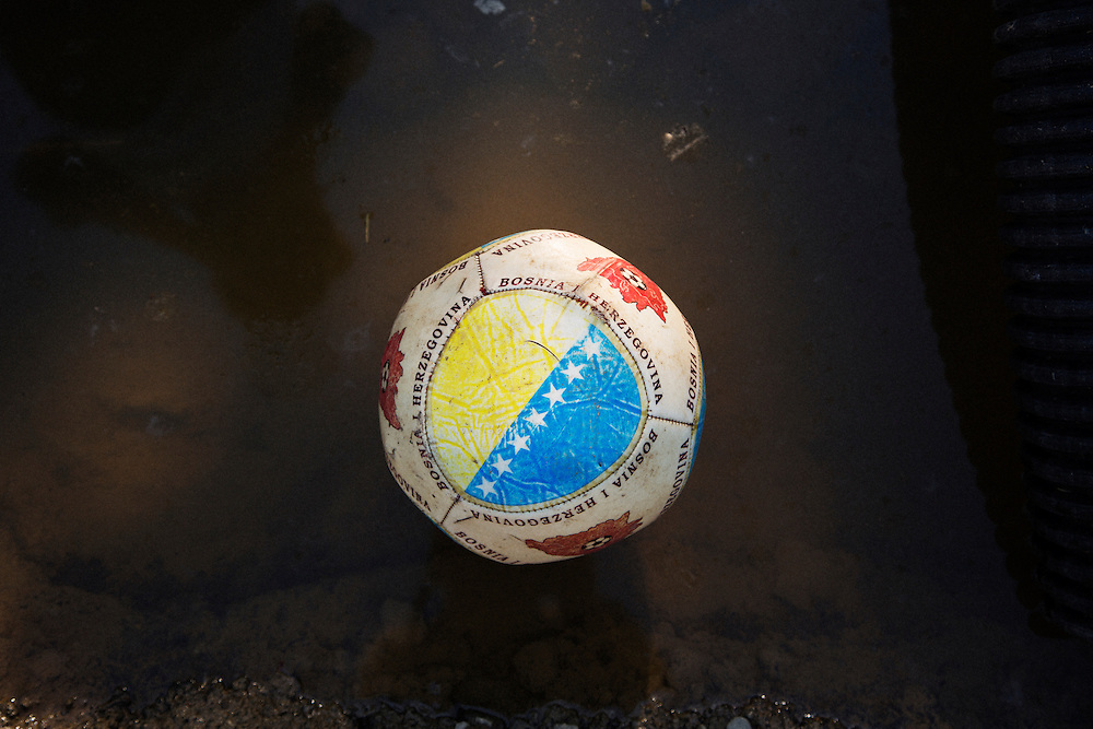 """Rescue crews from """"Four Paws"""" operate in Obrenovac, Serbia. A Bosnia and Herzegovina football found in Serbia.<br /> <br /> Matt Lutton / Boreal Collective<br /> <br /> Flooding in Serbia"""