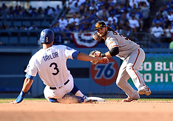 March 29, 2018 - Los Angeles, CA, U.S. - LOS ANGELES, CA - MARCH 29: San Francisco Giants Shortstop Brandon Crawford (35) turns towards first for a double play against Los Angeles Dodgers Outfield Chris Taylor (3) during the MLB opening day game between the San Francisco Giants and the Los Angeles Dodgers on March 29, 2018 at Dodger Stadium in Los Angeles, CA. (Photo by Chris Williams/Icon Sportswire) (Credit Image: © Chris Williams/Icon SMI via ZUMA Press)