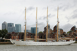 © Licensed to London News Pictures. 26/08/2015.  Four masted tall ship Santa Maria Manuela passes Canary Wharf as she arrives in London. The 63 metre long tall ship is in London until next week. A number of tall ships have arrived in London today in rainy weather including the Chilean navy's four masted sail training ship Esmerelda. Other ships are heading to south east London for a tall ships event which is part of the Mayor of London's Totally Thames festival. Credit : Rob Powell/LNP