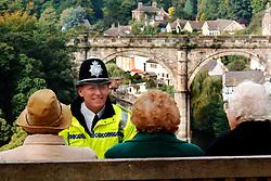 Policeman chatting to three elderly women Knaresborough Yorkshire UK