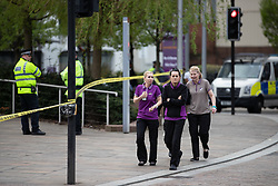 © Licensed to London News Pictures. 22/04/2018. Manchester, UK. Evacuated staff outside the police cordon . Police are responding to a suspect package at a premier Inn Hotel near to Victoria Station in Manchester City Centre . The bomb squad are in attendance and the hotel has been evacuated . Photo credit: Joel Goodman/LNP