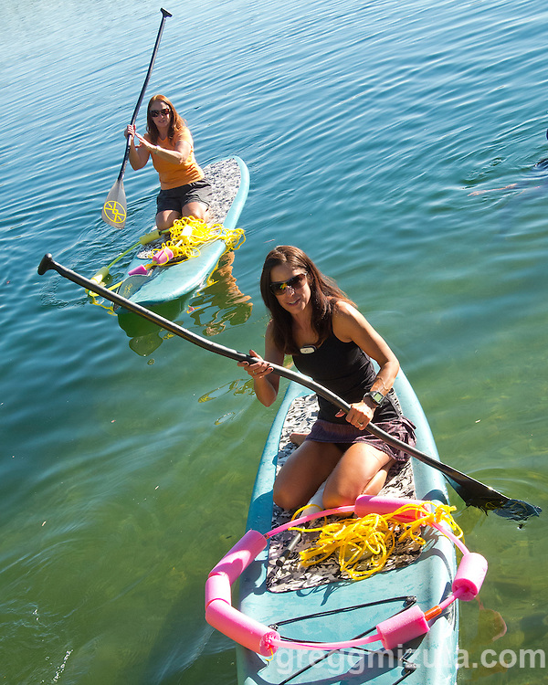 Michelle Tullis and Jo Cassin at Western Capital Bank's first annual SUP & SIP event at Quinn's Pond and Idaho River Sports in Boise, Idaho on September 5, 2012.