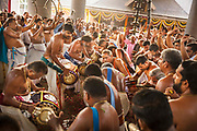 Musicians drumming inHindu spring festival in Temple on 28th February 2018 near Kovalam, Kerala, India.