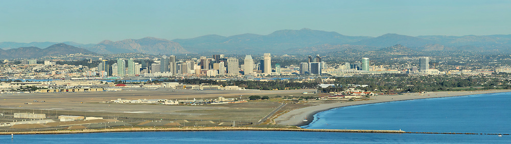 Downtown San Diego skyline with North Island Naval Air Station and harbor entrance in foreground. <br /> <br /> Panoramic available up to 14479 x 4101.