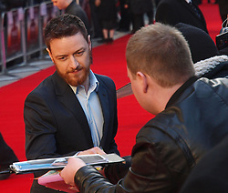 James McAvoy signs autographs for his fans as he arrives for the Premiere of  his new film 'Trance' in London's Leicester Square Tuesday March 19, 2013. Photo by Max Nash / i-Images...