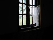 A net curtain at a window in the old Catholic church in Song Duu Kayan ethnic minority village in Kayah State, Myanmar on 15th November 2016