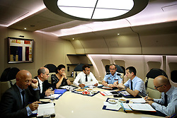 France's President Emmanuel Macron, center, confers with officials aboard the presidential plane en route to Guadeloupe Island, the first step of his visit to French Caribbean islands, Tuesday, Sept. 12, 2017. Seated at the table from left are French Education Minister Jean-Michel Blanquer, 2nd left, French Minister for Solidarity and Health Agnes Buzyn, Director General of the Gendarmerie Nationale, Richard Lizurey, director of the rescue service (Securit» Civile), Jacques Witkowski, 2nd right. Photo by Christophe Ena/Pool/ABACAPRESS.COM