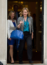 © Licensed to London News Pictures. 02/06/2015. Westminster, UK. Secretary of State for Environment, Food and Rural Affairs LIZZ TRUSS (left) and Secretary of State for Energy and Climate Change AMBER RUDD (right) leaving Number 10 Downing Street in London following a cabinet meeting. Photo credit: Ben Cawthra/LNP