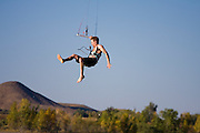 Anthony Pigliacampo is pulled into the air while kite boarding on Boulder Reservoir outside Boulder, Colorado.