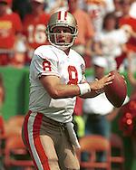 San Francisco 49er quarterback Steve Young drops back to pass against the Kansas City Chiefs at Arrowhead Stadium in Kansas City, Missouri.