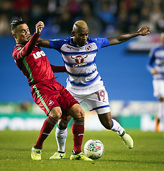 Reading's Leandro Bacuna (right) and Swansea City's Roque Mesa during the Carabao Cup, third round match at the Madejski Stadium, Reading.