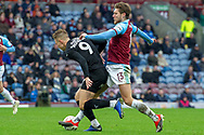 Barnsley forward Cauley Woodrow (9) is fouled by Burnley midfielder Jeff Hendrick (13) during the The FA Cup 3rd round match between Burnley and Barnsley at Turf Moor, Burnley, England on 5 January 2019.
