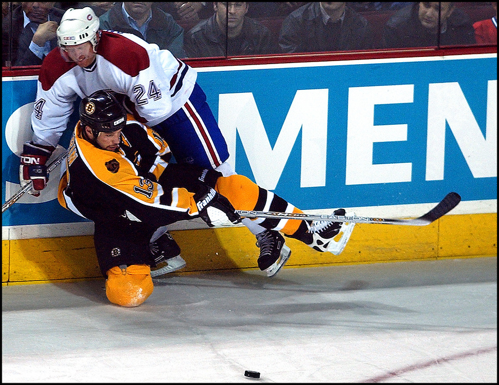 (04/29/2002-Montreal, Canada) Boston Bruins vs Montreal Canadiens. Bruins Bill Guerin loses control of the puck as he is taken down by #24 Andreas Dackell in the 3rd period. (042902bruinsmjs-Staff Photo by Michael Seamans. Saved in Photo Tuesday.)