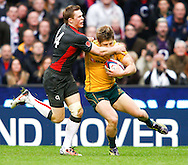 Chris Ashton of England tackles James O'Connor of Australia during the Investec series international between England and Australia at Twickenham, London, on Saturday 13th November 2010. (Photo by Andrew Tobin/SLIK images)