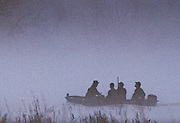Duck hunters on a foggy morning in the Mississippi delta.