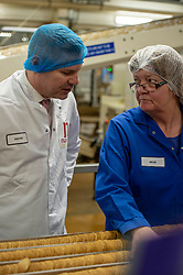 Pictured: Derek Mackay chatter bto helen on the production line<br /> <br /> Economy Secretary Derek Mackay visited Nairn's Oatcakes in Edinburgh today to comment on the latest export and GDP statistics. Mr Mackay enjoyed a short tour of the factory where staff demonstrated the manufacturing process.<br /> <br /> Ger Harley | EEm 30 January 2019