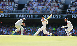 Australia's Steve Smith r plays a shot as England's Jonny Bairstow looks on during day two of the Ashes Test match at The Gabba, Brisbane.