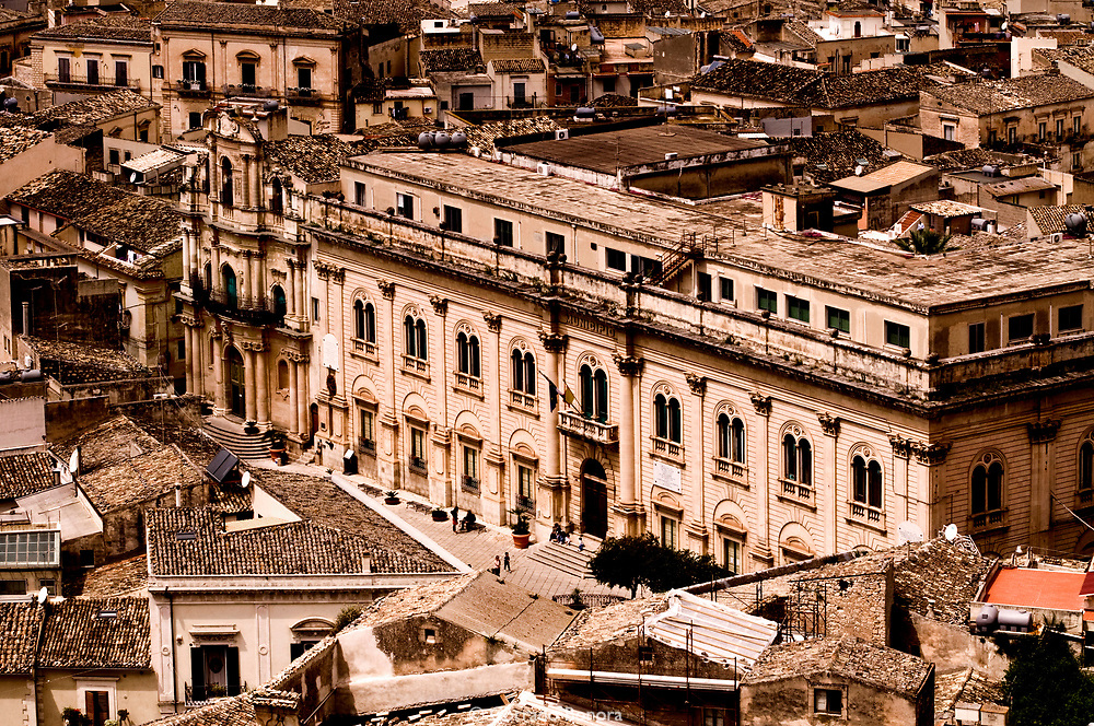 """City Hall. Scicl, Sicily. Val di Noto, Unesco World Heritage. Location of the italian television series """"The Inspector Montalbano"""" directed by Alberto Sironi (RAI). The films contributed greatly popularity to the sicilian writer Andrea Camilleri and his decetive stories in """"Vigata"""" an imaginary town."""