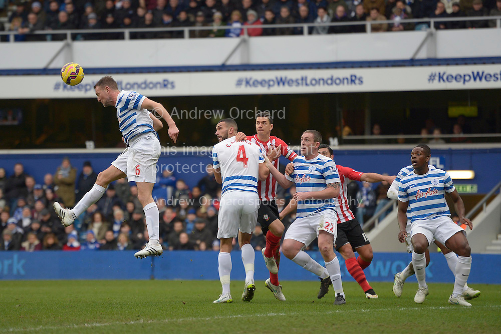 Clint Hill of QPR heads the ball clear. Barclays Premier league match, Queens Park Rangers v Southampton at Loftus Road in London on Saturday 7th Feb 2015. pic by John Patrick Fletcher, Andrew Orchard sports photography.