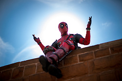 © Licensed to London News Pictures . 30/07/2017 . Manchester , UK . Deadpool (Wayne Parker) outside the venue . Cosplayers, families and guests at Comic Con at the Manchester Central Convention Centre . Photo credit : Joel Goodman/LNP