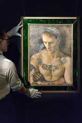 """© Licensed to London News Pictures. 01/06/2018. LONDON, UK. A Sotheby's technician presents """"The Rose Necklace"""", by Pavel Tchelitchew (Est. GBP60-80k) at a preview of the Russian Pictures and Russian Works of Art, Fabergé & Icons sale which will take place at Sotheby's, New Bond Street on 5 June.  Photo credit: Stephen Chung/LNP"""