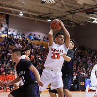 Josh Lynch (33) grabs a rebound  for Gallup in a game against Miyamura at the 75th Annual Gallup Boys Invitational Basketball Tournament, Saturday, Jan. 5, 2019 at Gallup High School.