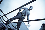 Construction Worker Standing On Rebar