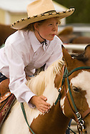 Girl rides horse at kids rodeo in Livingston Montana