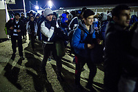 IDOMENI, GREECE - FEBRUARY 10: A group of refugees walk towards the FYROM border as their turn to cross the border had been called by the authorities at the Idomeni refugee camp on February 10, 2015 in Idomeni, Greece. Around 50 refugees from Syria, Iraq, Afghanistan are allowed to cross the border to the Former Yugoslav Republic of Macedonia. FYROM's authorities allow refugees to cross the border with the condition that Greek authorities clearly document the refugees' country of final destination. Photo: © Omar Havana. All Rights Are Reserved
