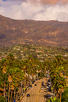 High angle view of Cabrillo Boulevard along the waterfront with Santa Ynez Mountains in background, Santa Barbara, California USA.