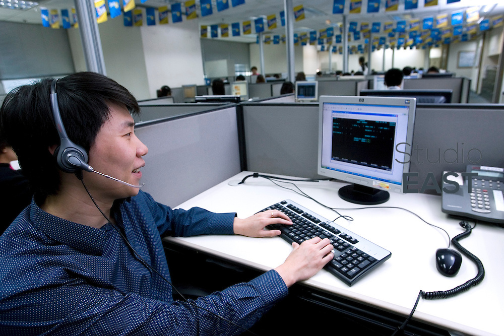 GUANGZHOU, CHINA - May 26: Jimmy Ho answers clients' phone calls at Citigroup Data Processing Center on May 26, 2010 in Guangzhou, Guangdong province, China. (Photo by Lucas Schifres/Getty Images)
