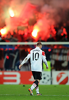 Football - Champions League - FC Basel vs. Manchester United<br /> Wayne Rooney of Manchester United looks dejected as he walks from the pitch in front of jubilant Basel fans at St. Jakob Park, Basel