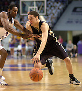 Colorado guard Richard Roby (R) drives against Kansas State's Akeem Wright (L) during the first half of the Wildcats 72-60 win over the Buffaloes at Bramalage Coliseum in Manhattan, Kansas, February 18, 2006.