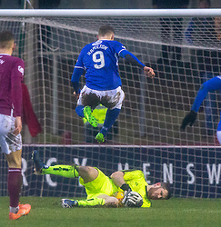Queen of the South's Jack Hamilton over Arbroath's keeper Derek Gaston. Arbroath 2 v 0 Queen of the South, Scottish Championship game played 15/2/2020 at Arbroath's home ground, Gayfield Park.