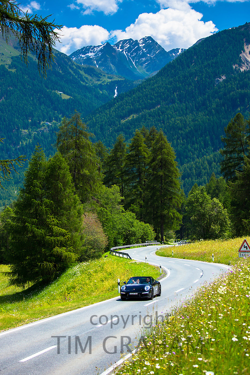 Porsche Boxster on touring holiday in the Swiss Alps, Swiss National Park, Switzerland