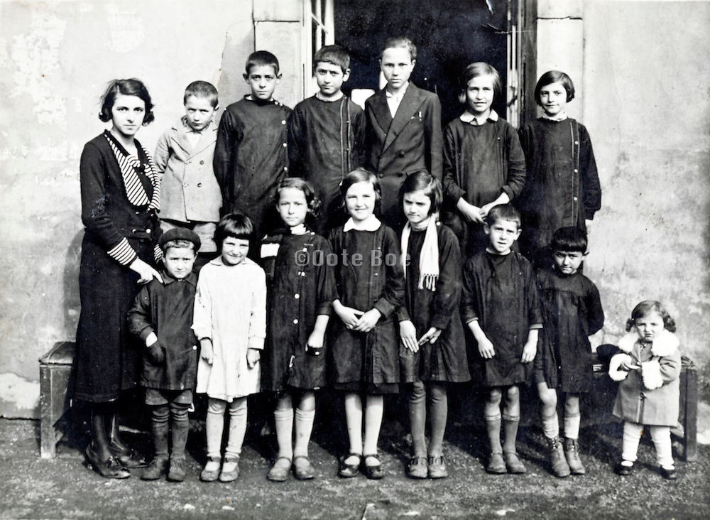 various aged school children and teacher rural France c 1930s