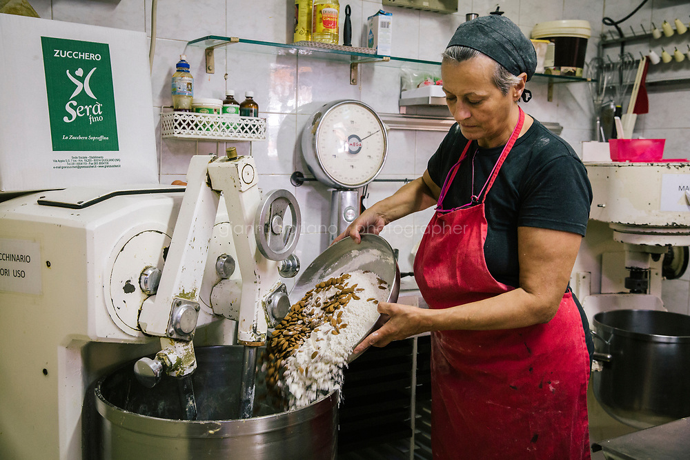 NAPLES, ITALY - 7 JUNE 2018: Lucia Tagliatela prepares the dough for quaresimali cookies, here at Pasticcielo, a bakery she opened 34 years ago in Naples, Italy, on June 7th 2018.<br /> <br /> Pasticciello was founded 34 years ago by Lucia Tagliatela.