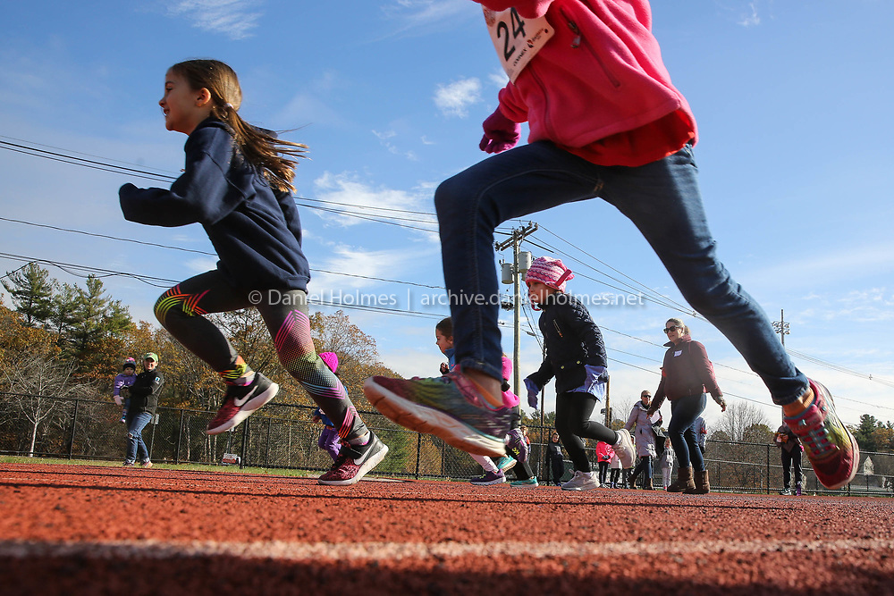 (11/12/17, NATICK, MA) Kindergarten runners compete in the 100-yard dash during the Apple Pi Fun Run at Natick High School on Sunday. [Daily News and Wicked Local Photo/Dan Holmes]