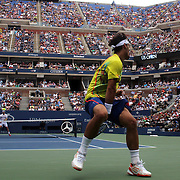 Fabio Fognini, Italy, plays a shot through his legs during his match with Andy Roddick, USA,  during the US Open Tennis Tournament, Flushing, New York. USA. 2nd September 2012. Photo Tim Clayton